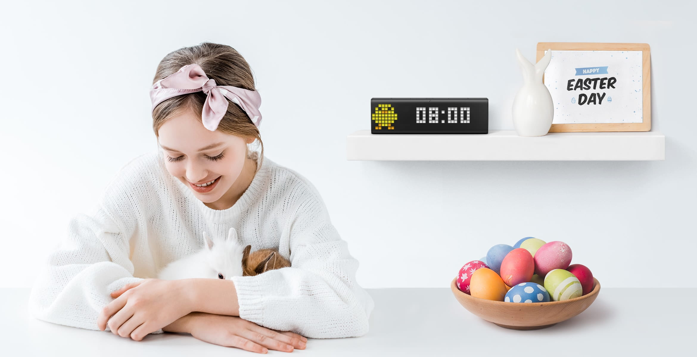 LaMetric Time smart clock shows time and a festive clock face, standing in a room with Easter Day decorations