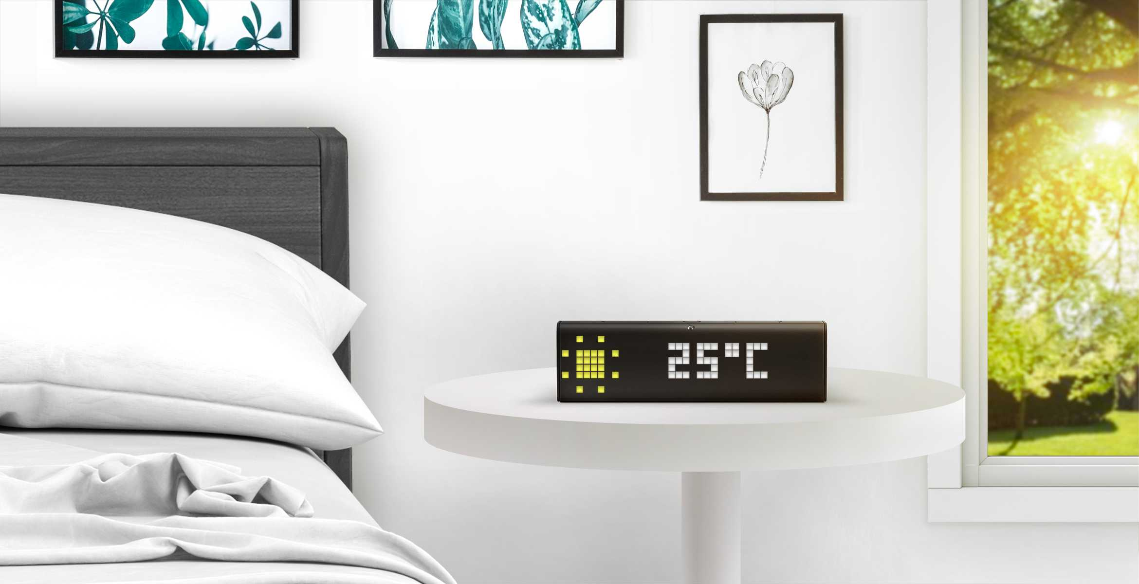 LaMetric Time digital clock displays weather, standing on the table near the bed