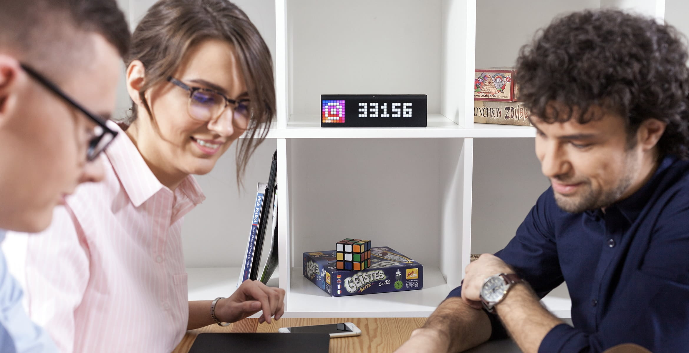 LaMetric Time smart clock, placed in a shelf, displays people follower count for the Instagram