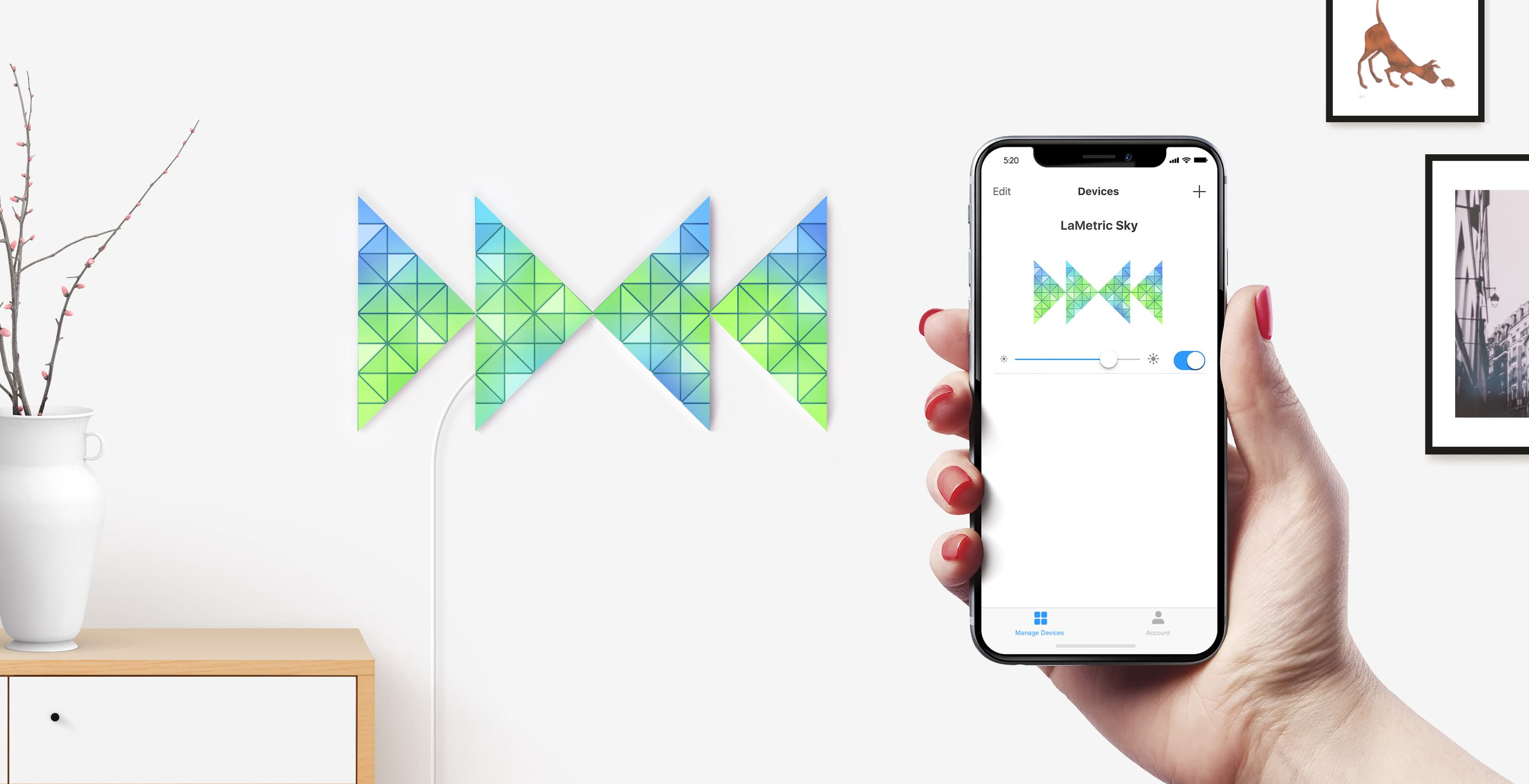 Bowtie shape, assembled from 4 smart light surfaces, complements room interior and iPhone shows ability to change brightness