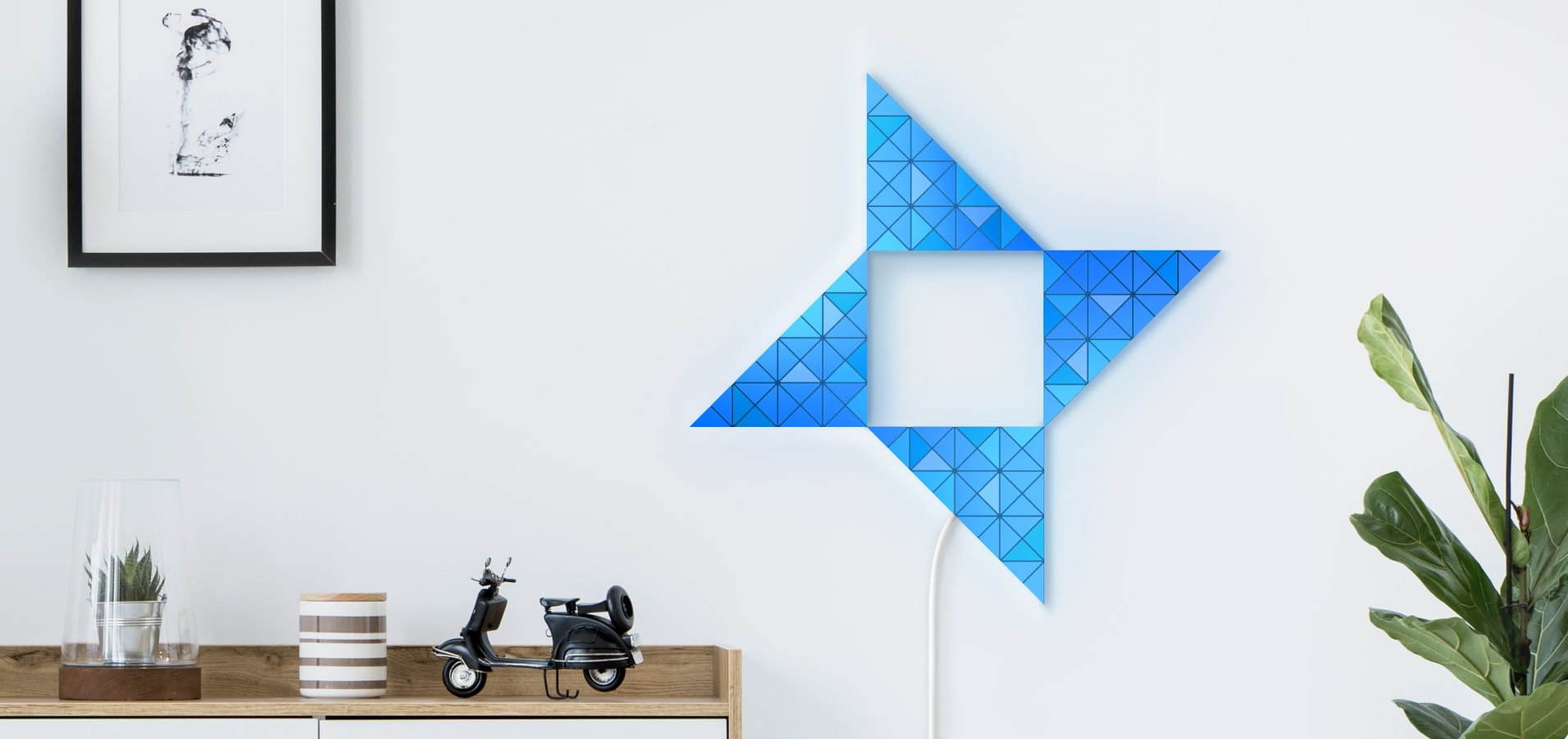 Bird shape in blue color assembled from 8 LaMetric SKY smart light surfaces