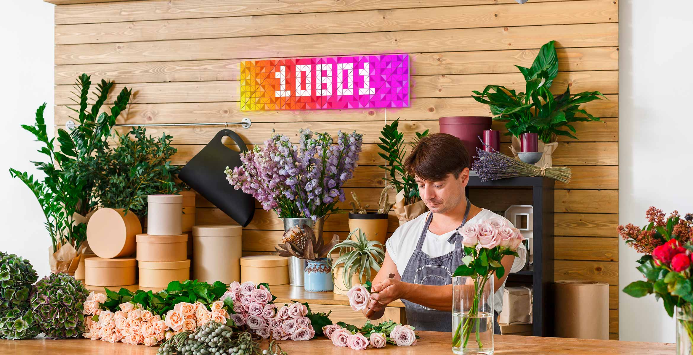 Infoscreen, assembled from 16 smart light surfaces, complements interior of flower shop and displays Instagram follower count