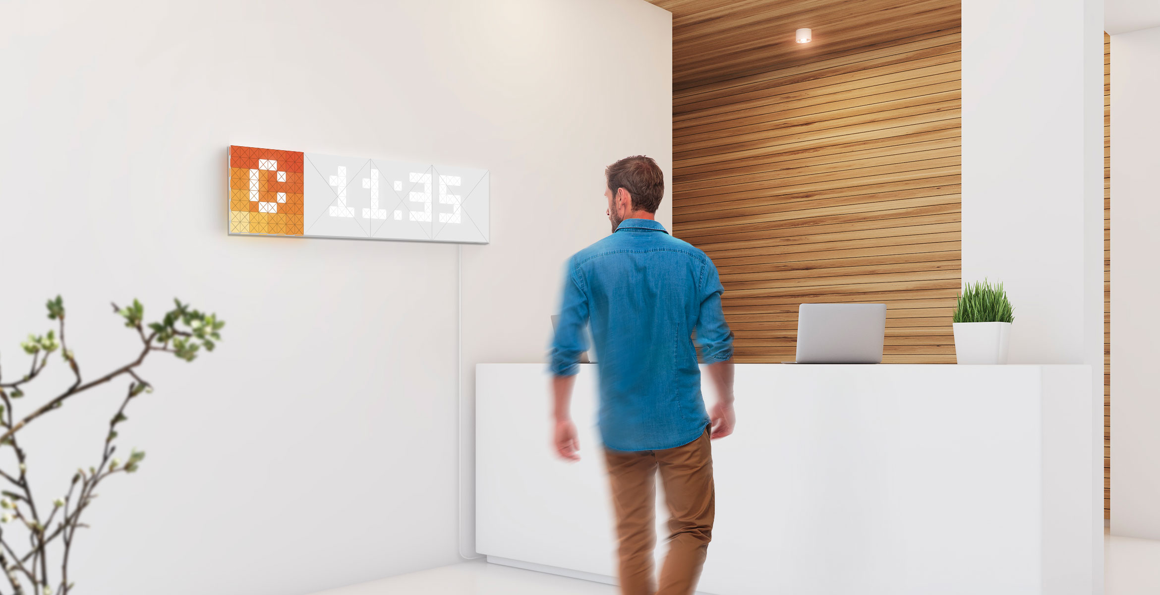 Infoscreen, assembled from 16 smart light surfaces, complements the office interior and displays time and company logo