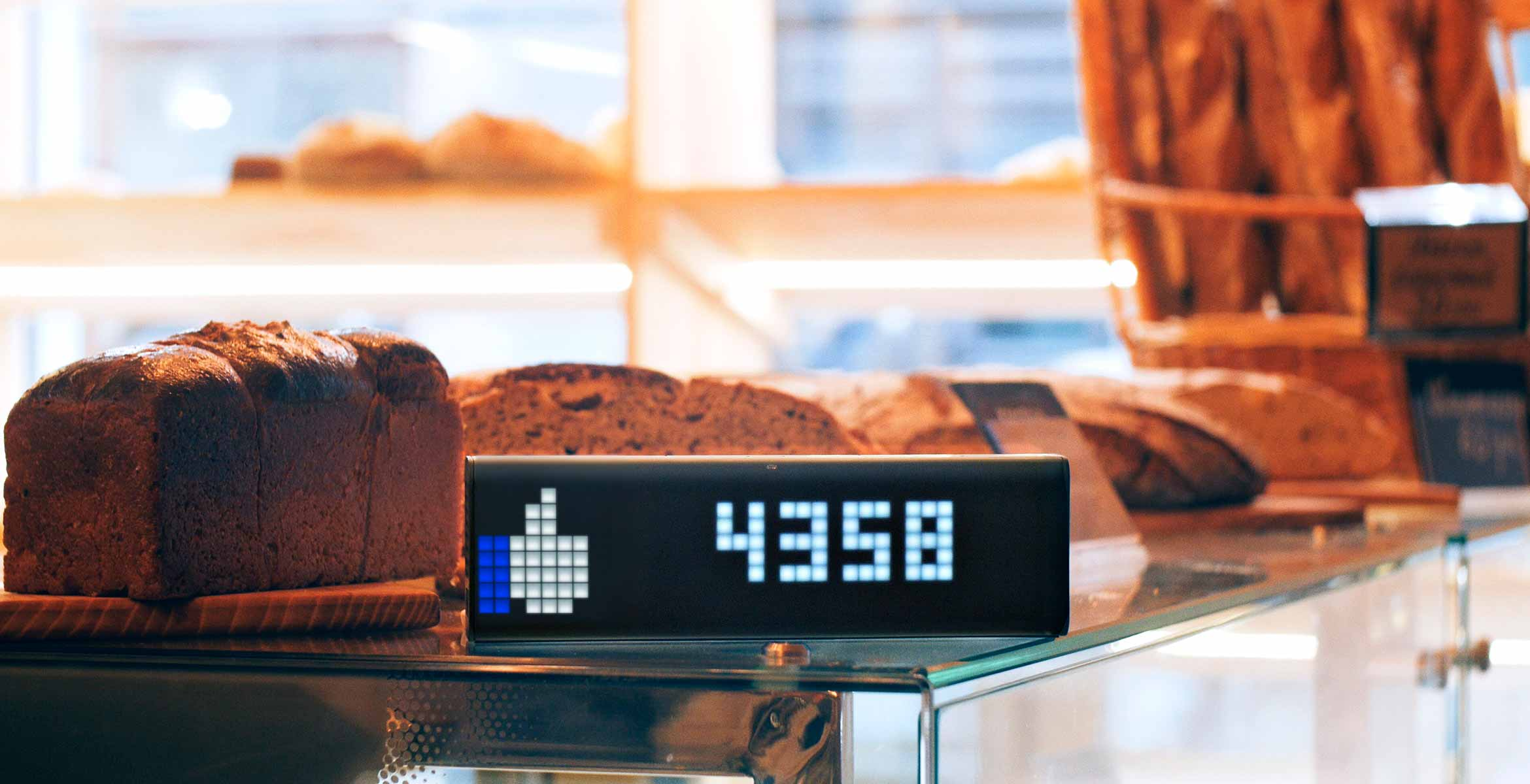 LaMetric Time smart clock, placed on the backery's shop front, displays Facebook like counter