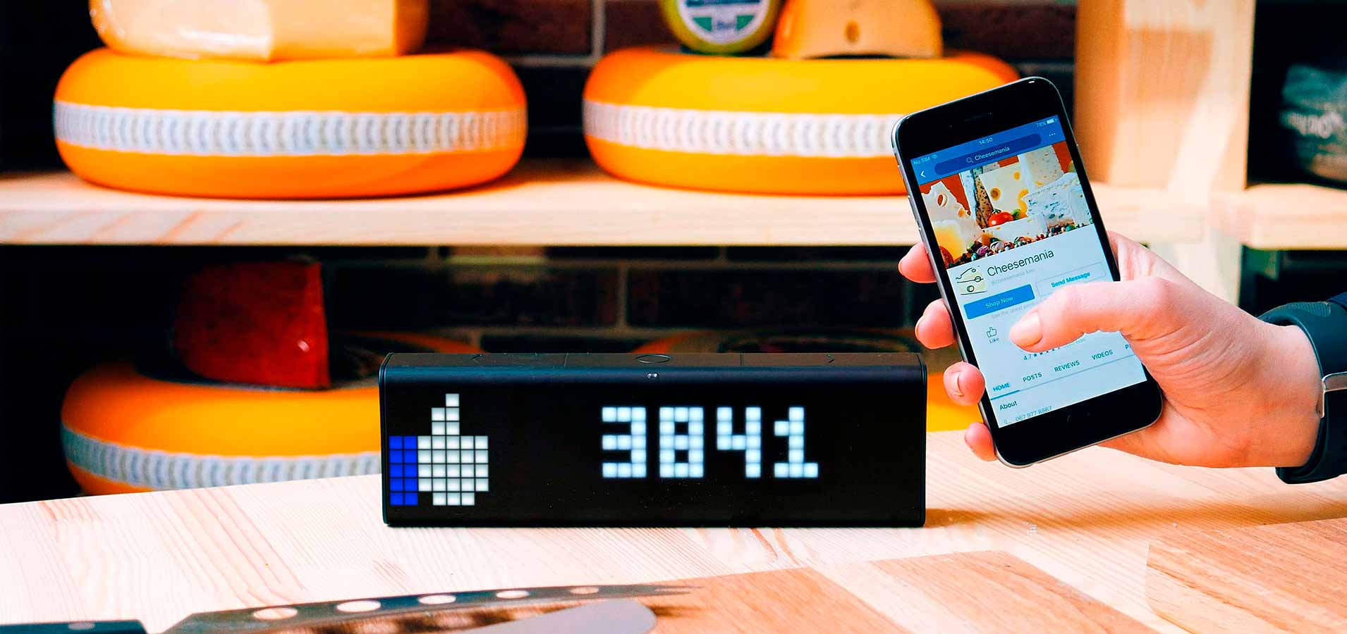 LaMetric Time smart clock for home and business in its' giftbox depicted as a perfect gift for co-workers and employees
