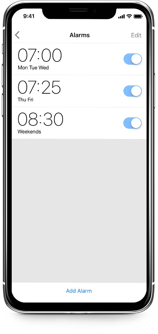 An iPhone shows alarms from LaMetric Time app for weekdays and weekend