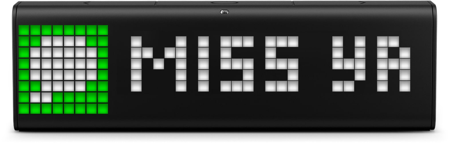 "LaMetric Time smart clock displays the incoming iMessage ""miss ya"""