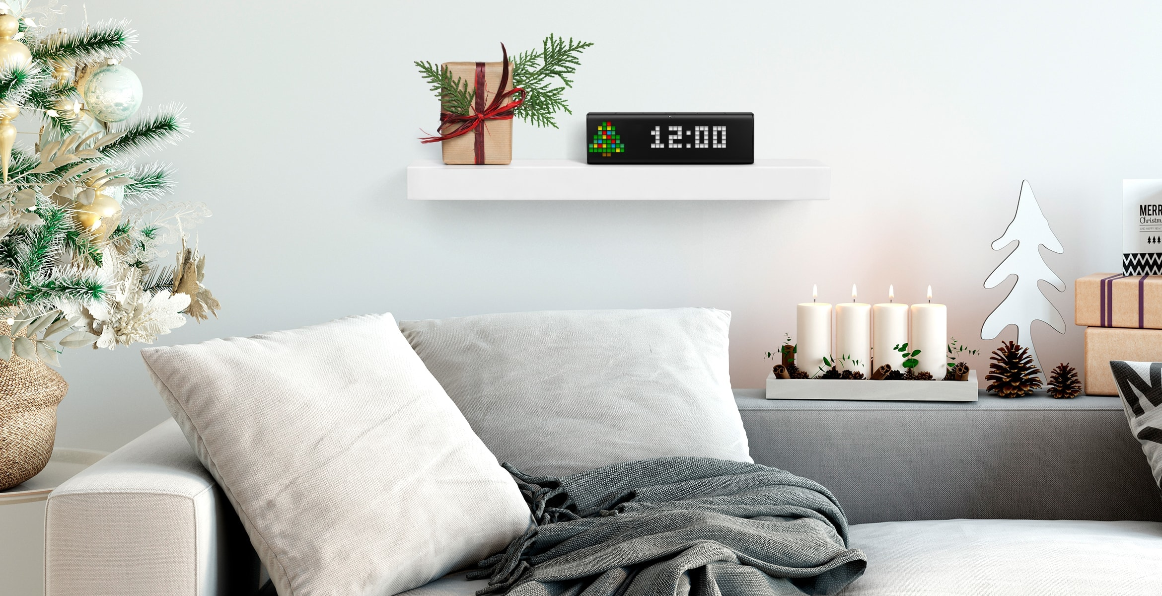 A digital clock stands on a shelf in the room with Christmas decorations, displays time and Christmas tree as a clock face