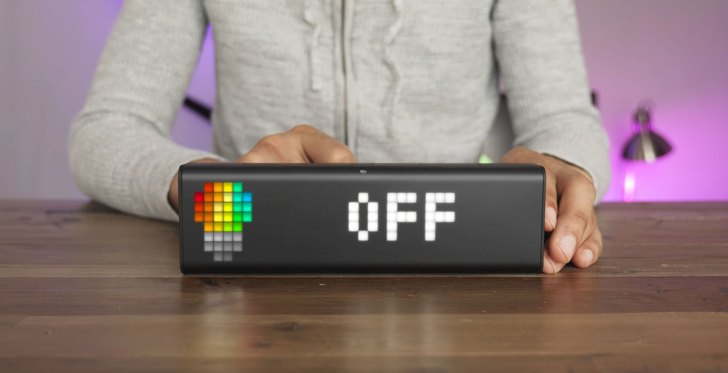 "Digital clock's integration with Philips Hue lights displaying a message ""OFF"" after you press on the action button"
