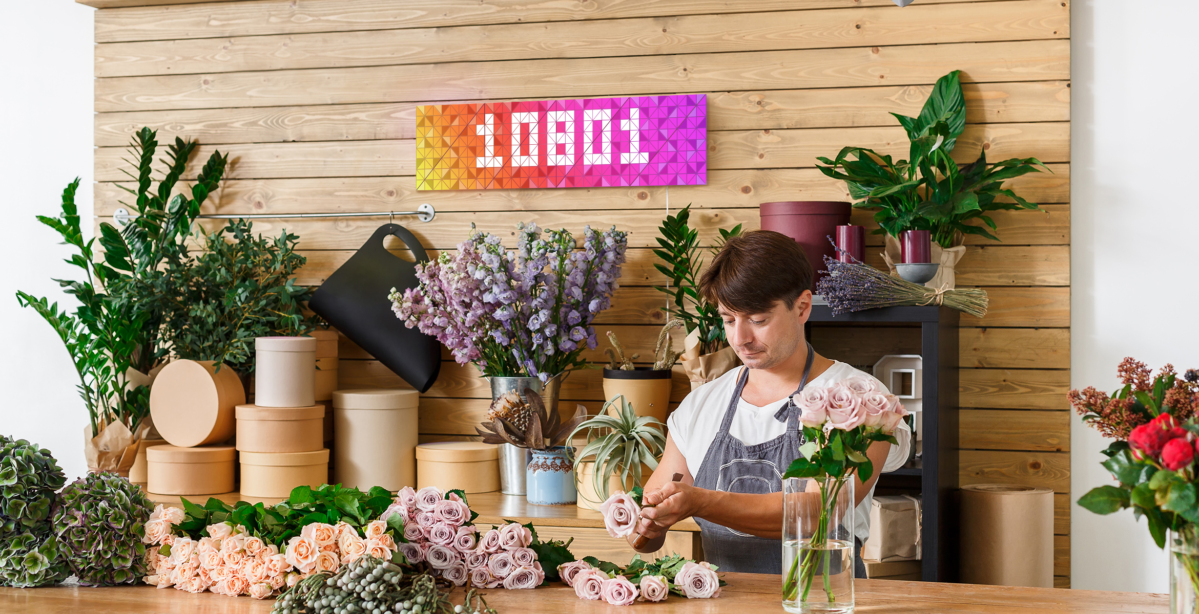 Infoscreen, assembled from 16 smart light surfaces, complements flower shop's interior and displays Instagram follower count