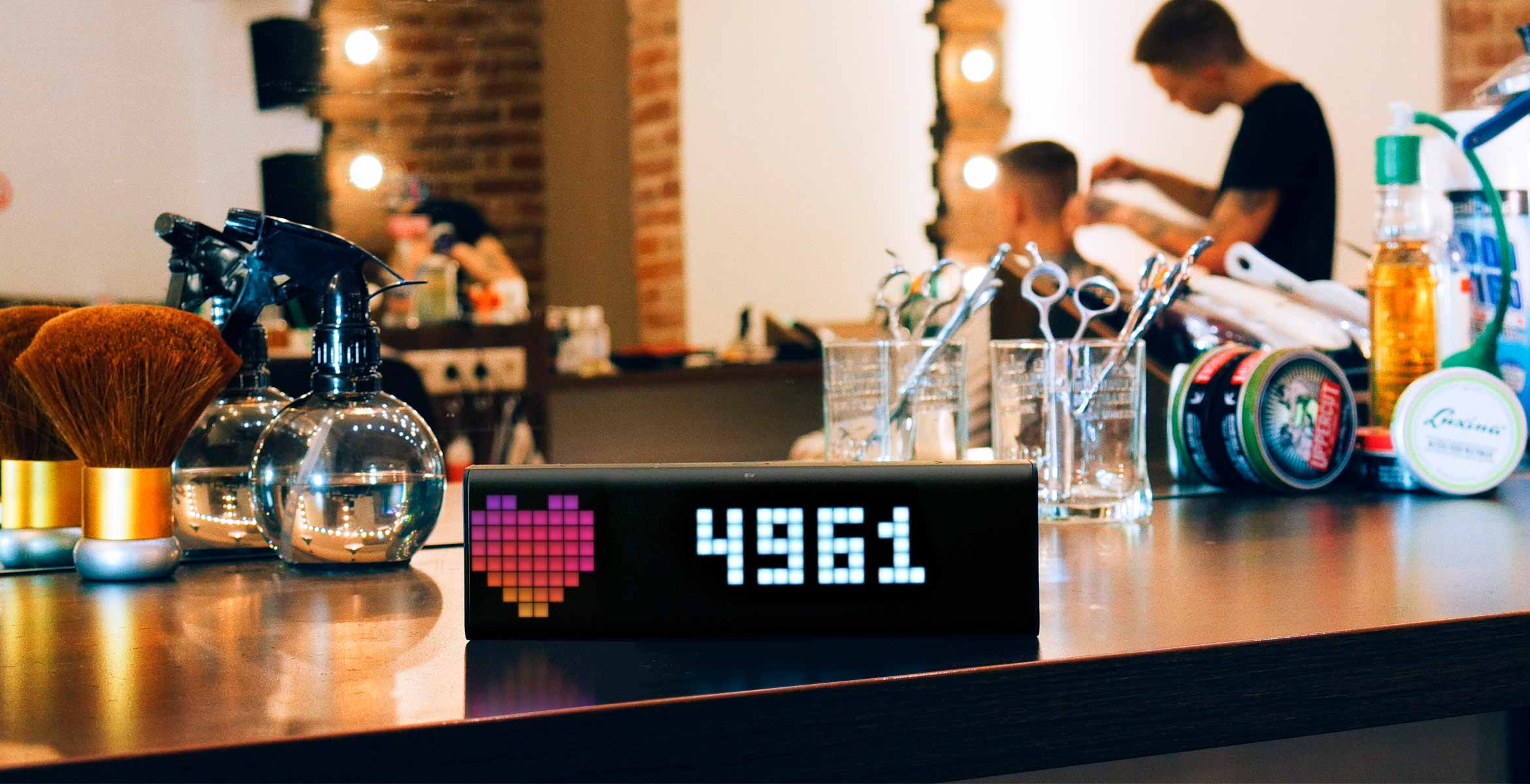 LaMetric Time smart clock, placed at the barbershop, displays follower count for your Instagram account