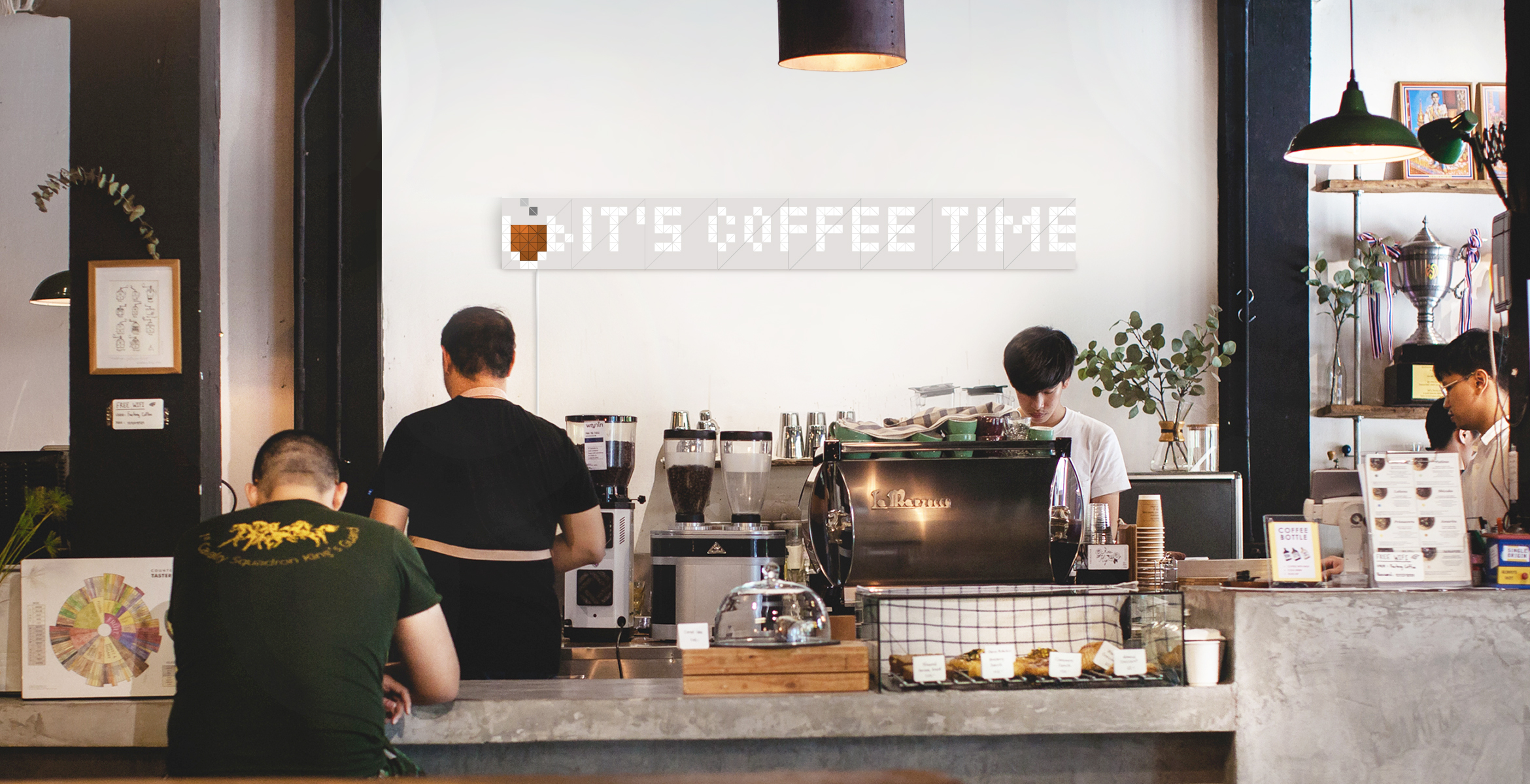 "Infoscreen, assembled from 16 smart light surfaces, complements cafe interior and displays a message ""It's coffee time"""
