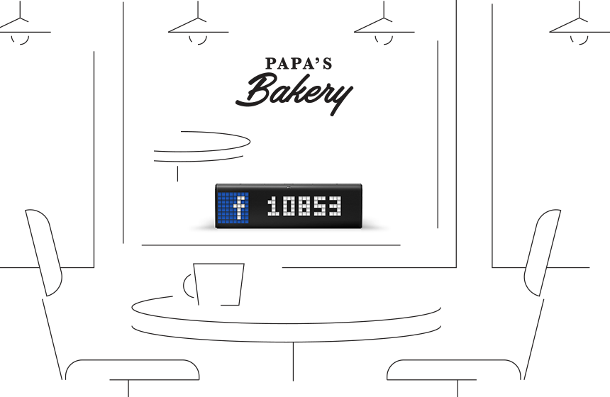 LaMetric Time digital clock, placed on a store front, shows Facebook like counter